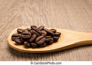 coffee beans seed. Grains in wooden spoon. Rustic.