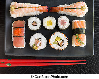 Selection of Seafood And Vegetable Sushi With Chopsticks (Overhead)