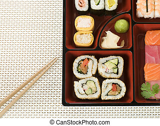 Selection of Sushi In a Bento Box with chopsticks