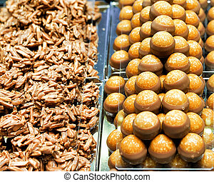 Selection of Swiss caramelized chocolate sweets with nut