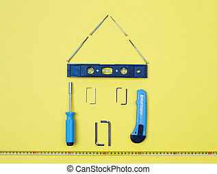 Selection of tools in the shape of a house.