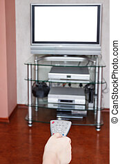 selection of TV channels by remote control at home