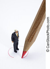 Red pencil circling businessman figurine