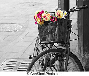 selective desaturation of an old bicycle with flowers in the...