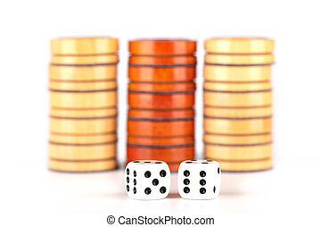 Backgammon dice and wooden checkers isolated on a white background.