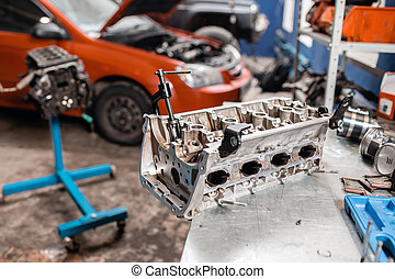 Selective focus. Engine Block on a repair stand with Piston...