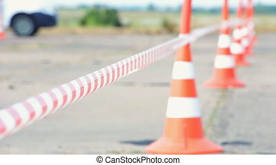 Fencing tape and road cone - Selective focus. Fencing tape...