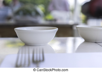 Selective focus image of empty white bowl