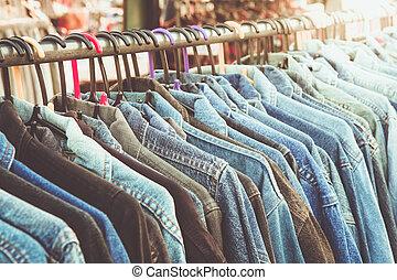 shirt - Selective focus jeans of shirt on rack