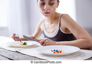 Selective focus of a plate with pills