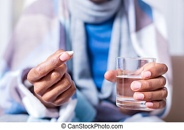 Selective focus of glass with water and a pill