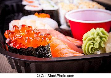 Selective focus of salmon caviar ikura sushi closeup