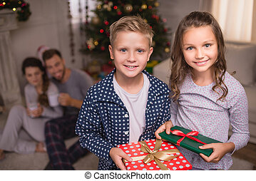 smiling children with christmas gifts