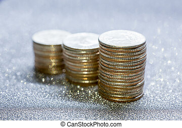 Selective focus of stack of US. dollar coins with glitter background