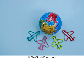 selective focus of travel in vacation concept - cute airplane fly over the world