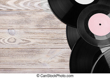 Selective focus of vintage vinyl records on top over wooden table. Copy space