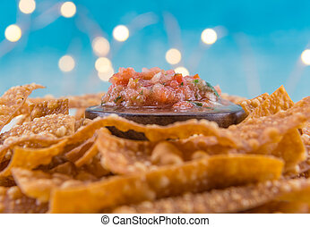 Selective Focus on Bowl of Salsa on Bed of Chips