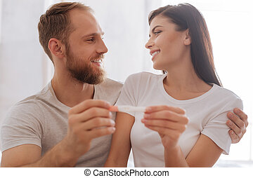 Selective focus on couple holding pregnancy test