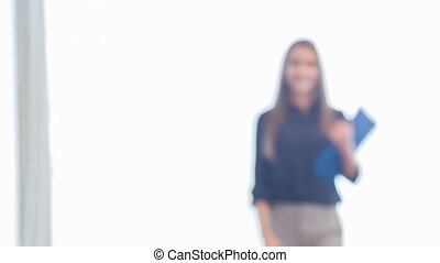 Selective focus on young dark-haired beautiful smiling woman