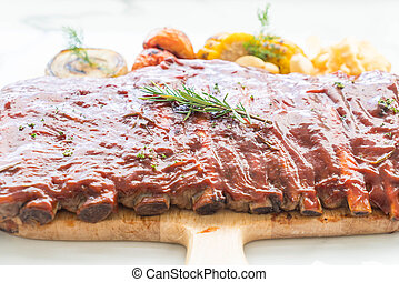 Grilled rib pork with barbecue sauce and vegetable and frech...