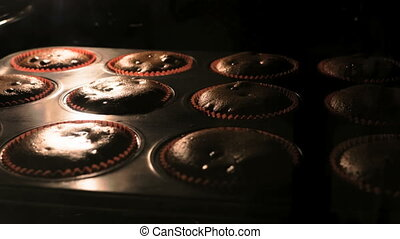 Selective focus shot of muffins baking, time-lapse
