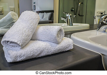 selective focus white towel on wash basin in luxury bathroom in hotel