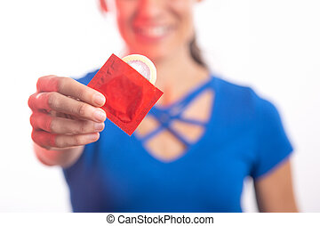 Selective focus, woman holding a red condom on white background.
