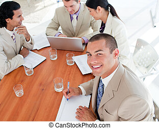 Self-assured business people in a meeting