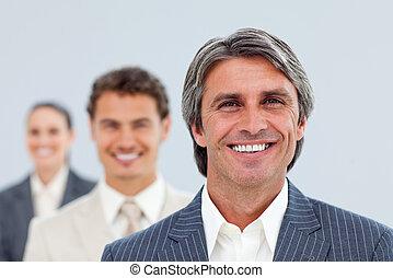Self-assured businessman and his team
