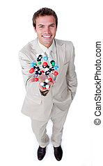 Self-assured businessman holding a molecule