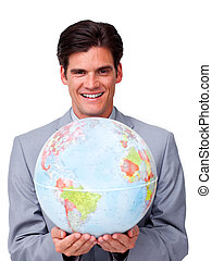 Self-assured businessman holding a terrestrial globe