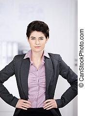 Self-assured businesswoman at work