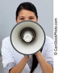 Self-assured businesswoman shouting instructions