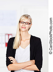 Self-assured businesswoman wearing spectacles standing with ...