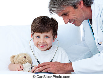 Self-assured doctor playing with a little boy