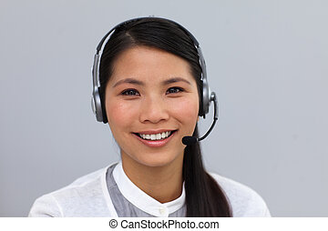 Self-assured ethnic businesswoman with headset on