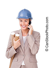 Self-assured female architect on phone standing