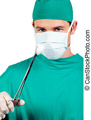Self-assured male surgeon holding surgical forceps against a...