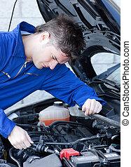 Self-assured man repairing a car