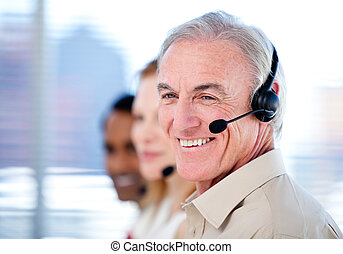 Self-assured sales representative team with headsets against...