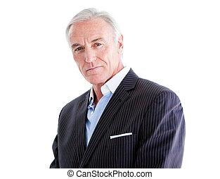 Self-assured senior businessman standing