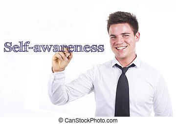 Self-awareness - Young smiling businessman writing on transparent surface
