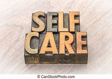 self-care word abstract in wood type - self-care word...