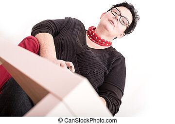 Self confident - A relaxed woman sitting in the living room....