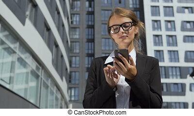 Self-confident Businesswoman Texting on Phone