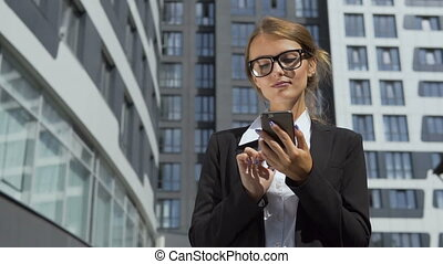 Self-confident Businesswoman Texting on Phone