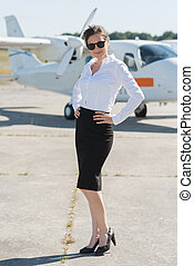 self confident businesswoman waiting for airplane