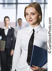 Self-confident gaze - Smiling blond Caucasian businesswoman...
