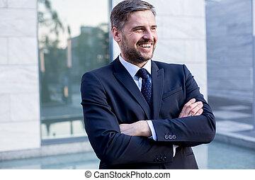 Self-confident handsome businessman in elegant suit