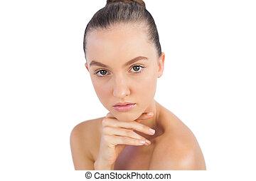Self confident model posing on white background